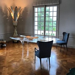 NOMAD MONACO David Gill Gallery room featuring Zaha Hadid dining table and MattiaBonetti torchere & dining chairs